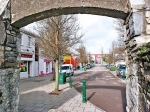 Under the arch to the Original square in Ballincollig, with the new Shopping centre just across the street . Photo Donagh Glavin