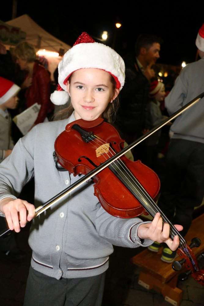Aine Woods playing some Christmas Music to celebrate the festive season in Ballincollig Picture: Ailish Murphy